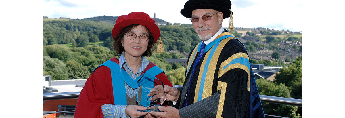 Professor Jane Jiang pictured with the University's former Chancellor Sir Patrick Stewart